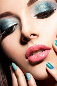 closeup of woman with makeup and painted nails